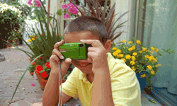 child taking digital photograph, easy to upload